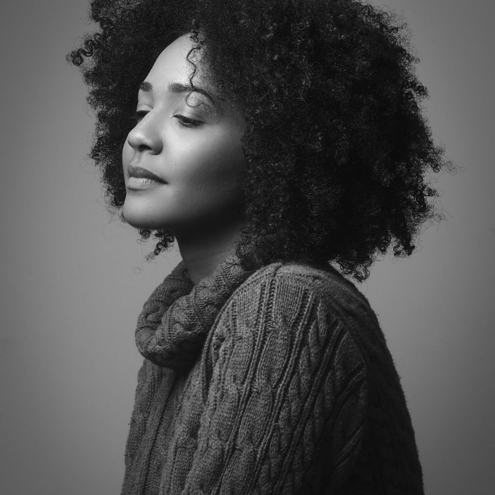 Black And White Portrait Of A Girl Wearing A Turtleneck Sweater