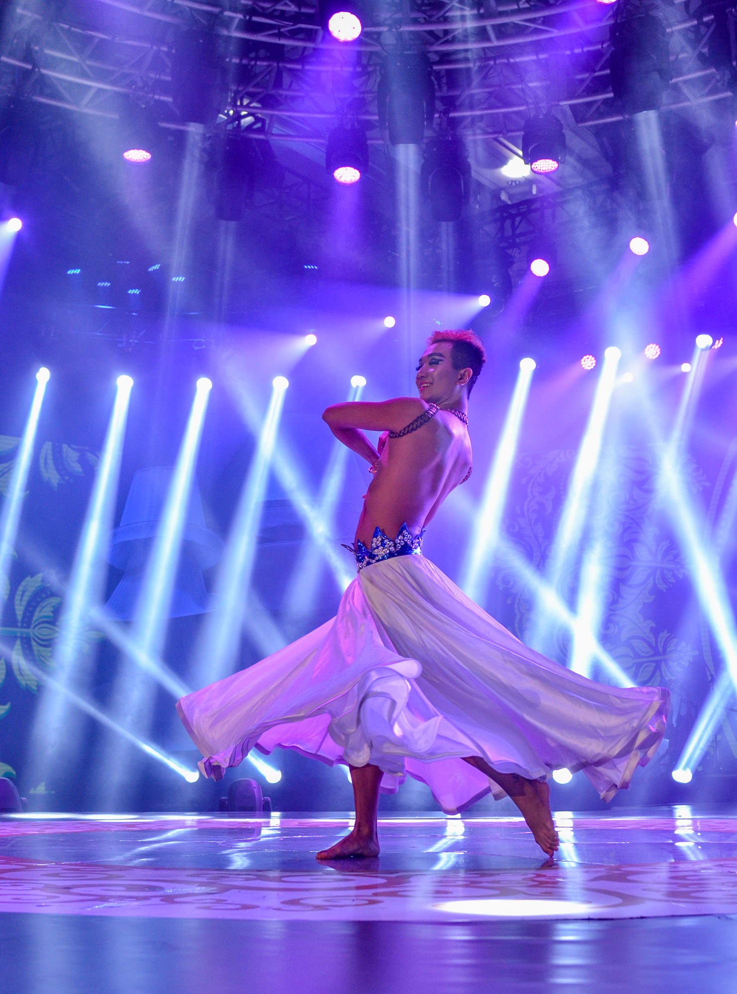 Digital photography of young male belly dancer contestant