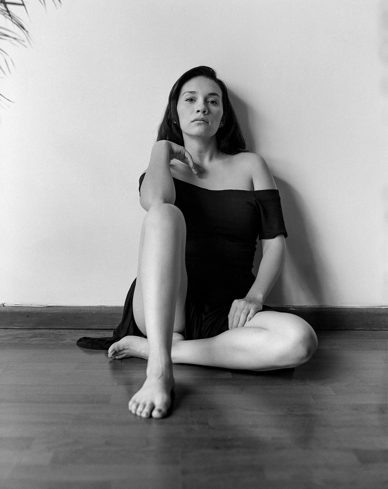 woman dressed in black situated on the floor