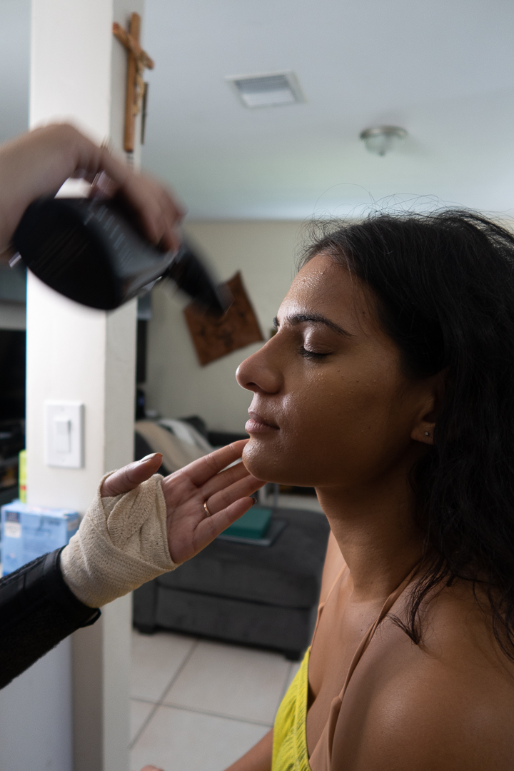 Makeup artist preparing client for photography session