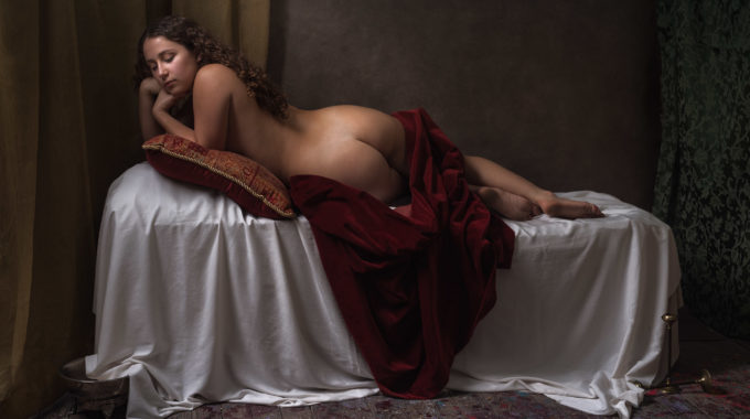 Nude Girl Laying On Bed Covered By Red Drape